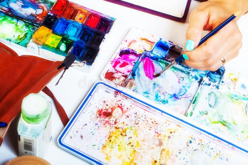 Close-up of the artist draws stock photo