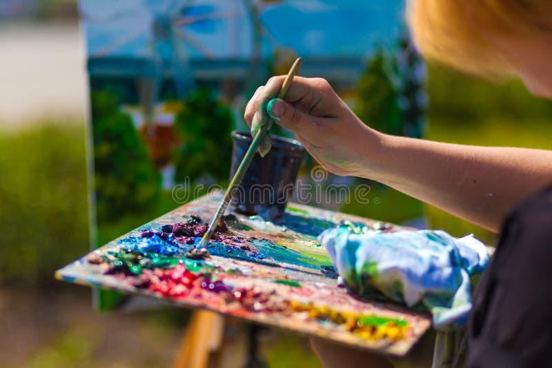 A close-up artist paints stock image