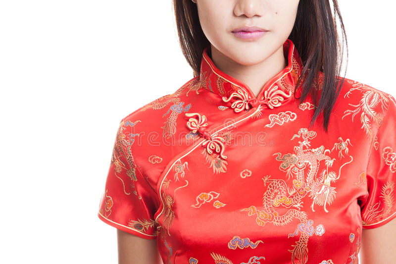Close up of Asian girl in chinese cheongsam dress. Close up of Asian girl in chinese cheongsam dress isolated on white background royalty free stock image