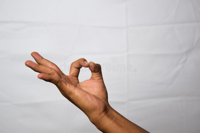 Close up Asian man shows hand gestures it means OK isolated on white background stock image