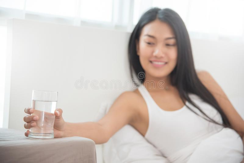 Close up Asian Woman holding glass of water. stock photo
