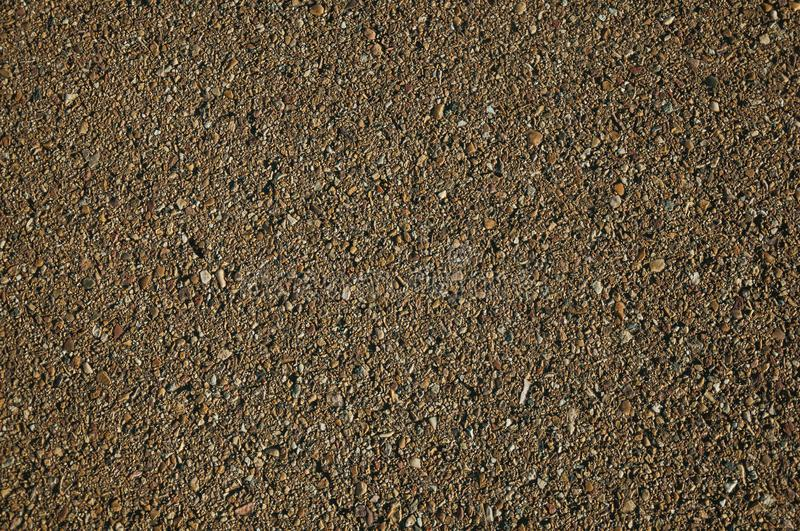 Close-up of asphalt with gravel inserted in it. Close-up of asphalt with small gravel inserted in it, on a countryside road at sunset near Elvas. A gracious star royalty free stock images