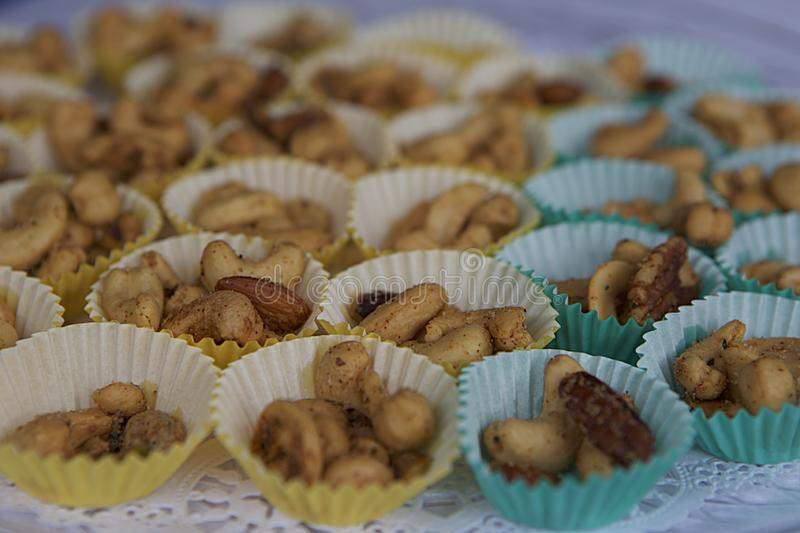 Mixed Nuts in Party Papers stock photography