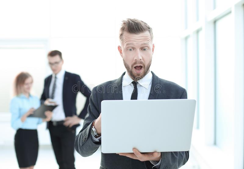 Close up.astonished businessman looking at laptop screen stock images