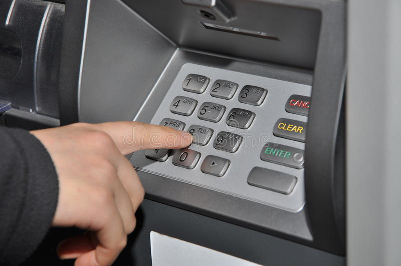 Close-up ATM machine. Someone pressing number button on ATM machine royalty free stock photography