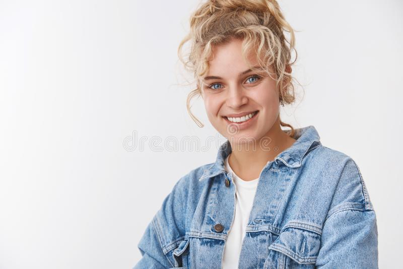 Close-up attractive friendly sociable blonde scandinavian girlfriend curly combed hairstyle smiling broadly white teeth stock photo