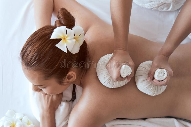 Close up of Attractive young Asian woman smiling and getting Spa treatment royalty free stock image