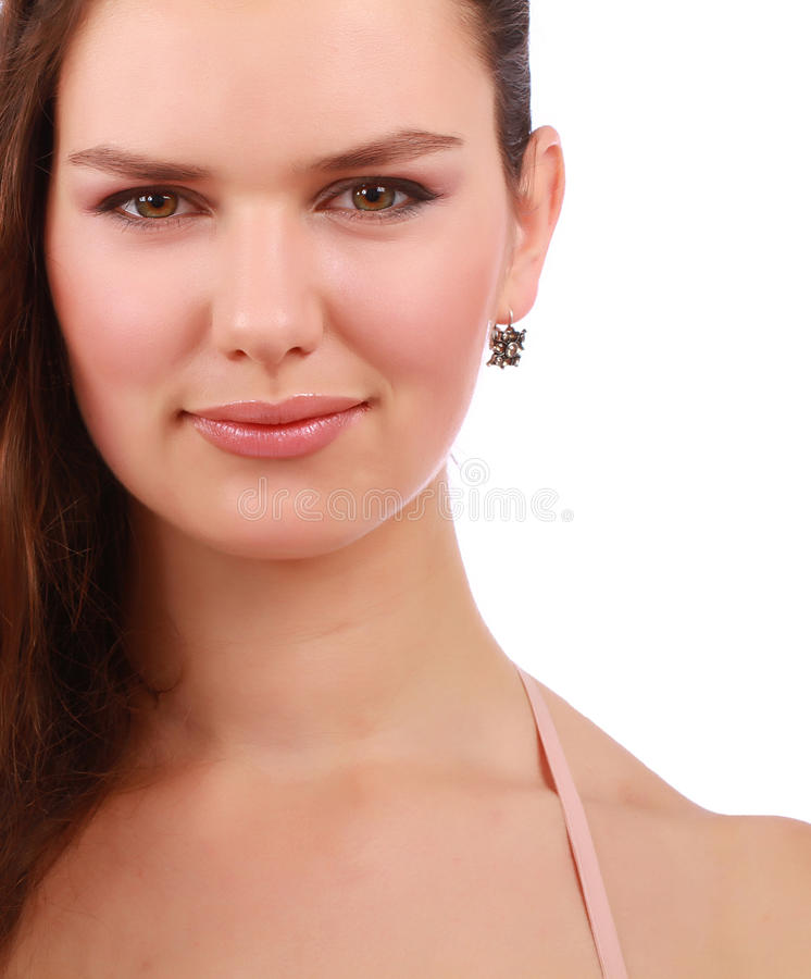 Close up of attractive young girl. Close up portrait of attractive young brown hair girl isolated on a white background stock image