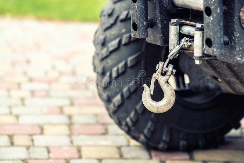 Close-up atv quadbike whick hook mounted on offroad all-terrain vehicle royalty free stock photos