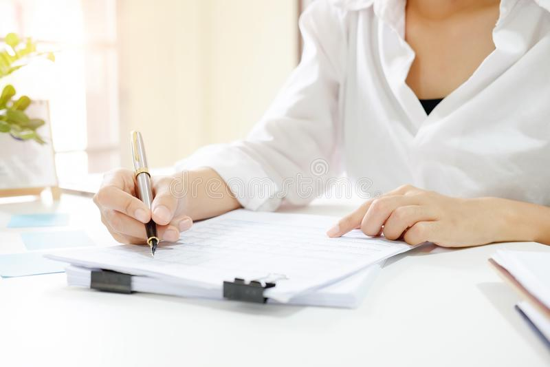 Close up audit woman calculate on paper document financial data. royalty free stock images