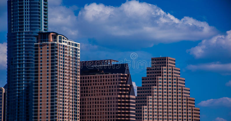 Close up on Austin Texas Office building Historic Skyline With New Austonian and Perfect Clouds and Blue sky royalty free stock image