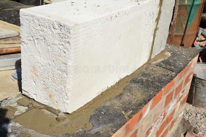 Close up on  autoclaved aerated concrete block laying on foundation waterproofing membrane. Photo royalty free stock image
