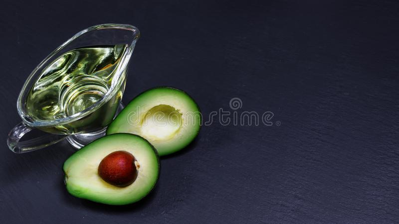 Close-up of an avocado and avocado oil shale board. Healthy food concept. copy space, top view stock photo