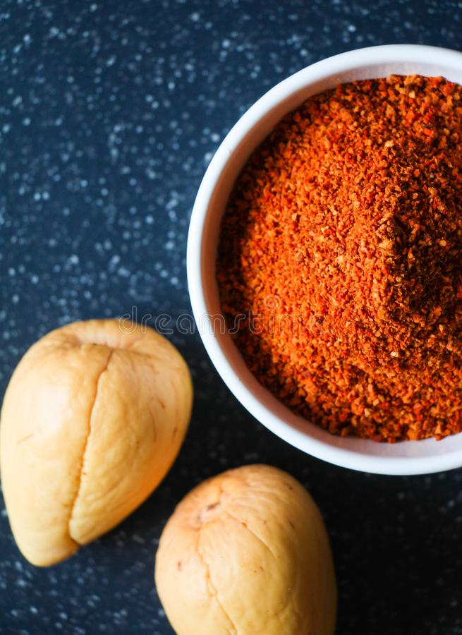 A close up of avocado seeds and seed powder in a cup royalty free stock images