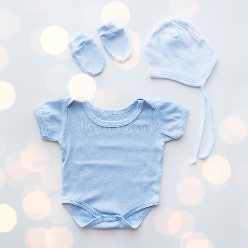 Close up of baby boys clothes for newborn on table royalty free stock images