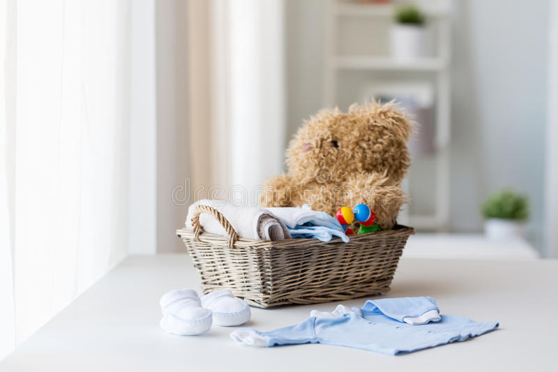 Close up of baby clothes and toys for newborn royalty free stock photos