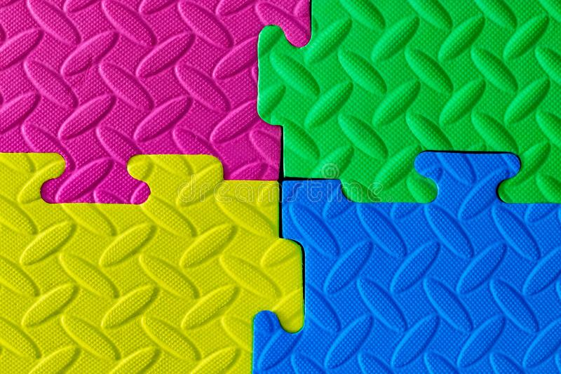 Close-up of baby playing mat background. Jigsaw soft rubber surf stock image