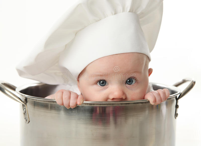 Close up of baby sitting in stock pot stock photography