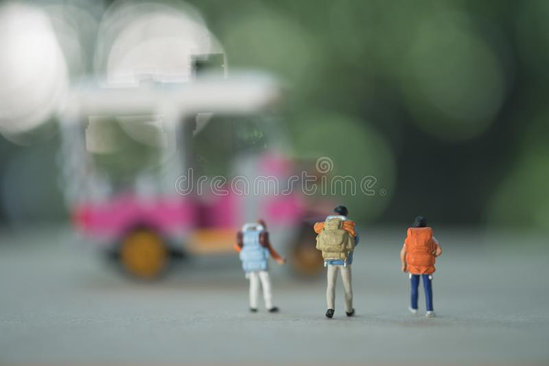 ..Close up of back of group of traveler miniature figure with backpack. Travel and journey concept royalty free stock image