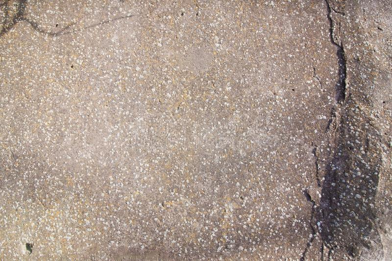 Close-up background of grey concrete shabby old cracked wall, horizontal rough abstract surface texture. Photo royalty free stock image