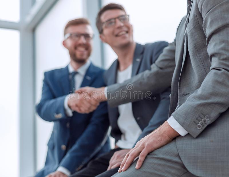 Close up. background image of a business handshake in the office lobby. stock photo