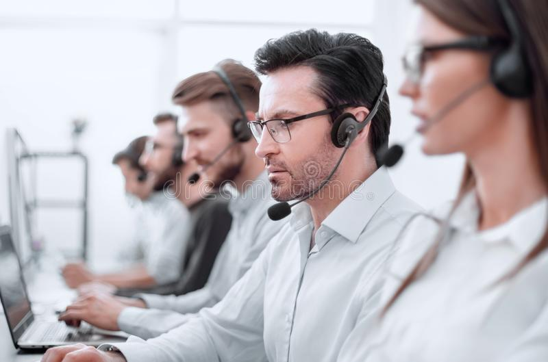 Close up.background image of call center employees in the workplace royalty free stock photography