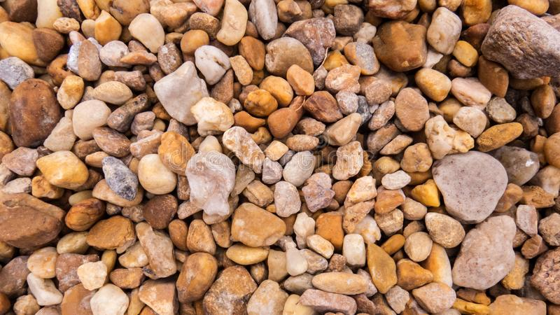 Small stones and pebbles scattered on the ground stock image