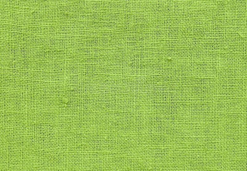 Close Up Background Pattern of Green Chartreuse Textile Texture. Textile Texture, Close Up of Green Chartreuse Sack or Burlap Fabric Pattern Background with Copy stock images