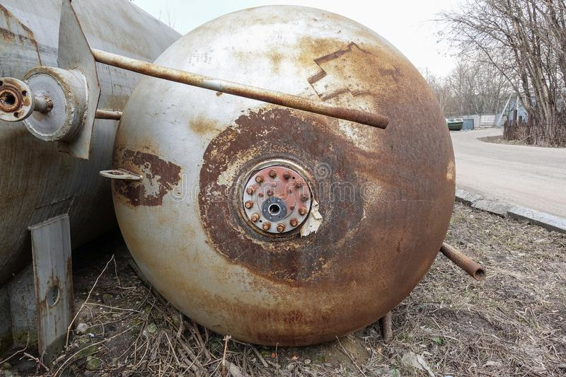 Close up background of rusty metal tank with rusty circular hole royalty free stock photos