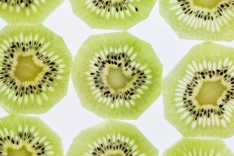 Close up of backlit kiwi slices. Background of backlit kiwi slices royalty free stock photo