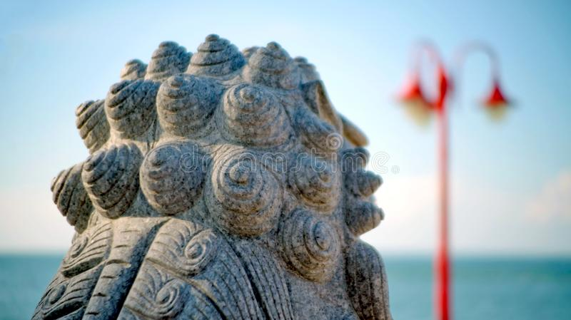Close up backside sculpture model on the beach. royalty free stock photos