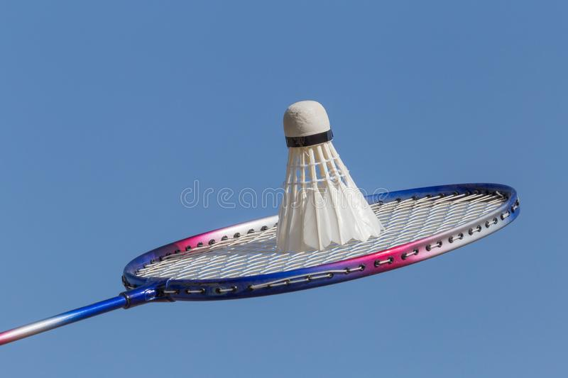 Close up of badminton racquet with shuttlecock. Against blue sky stock photography