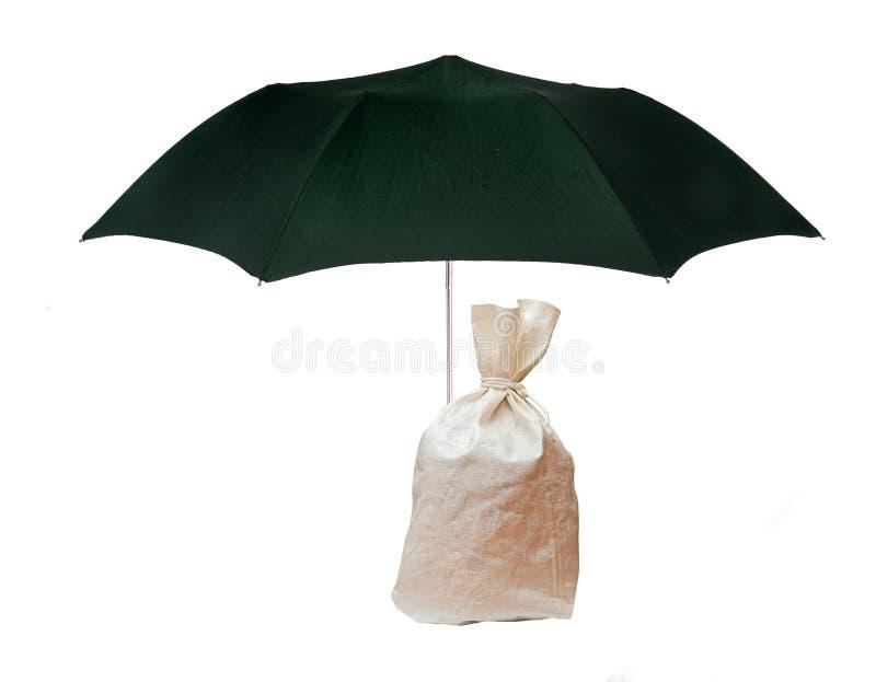 Bag  under umbrella royalty free stock photo