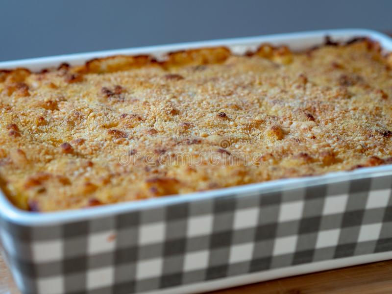 Close up of baked macaroni and cheese in a casserole dish royalty free stock images