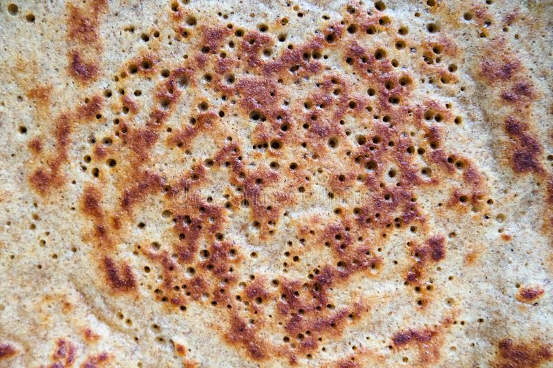 Close-up of baked pancake made from rye flour stock photos