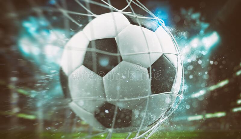 Close-up of a ball entering the net in a football match royalty free stock image