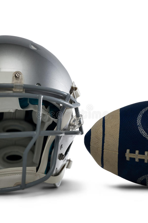 Close-up of ball and helmet. Against white background royalty free stock photo