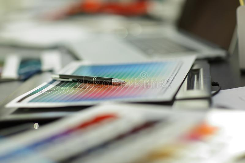 Close up.ball point pen and fabric samples on the table at the couturier.  royalty free stock photo