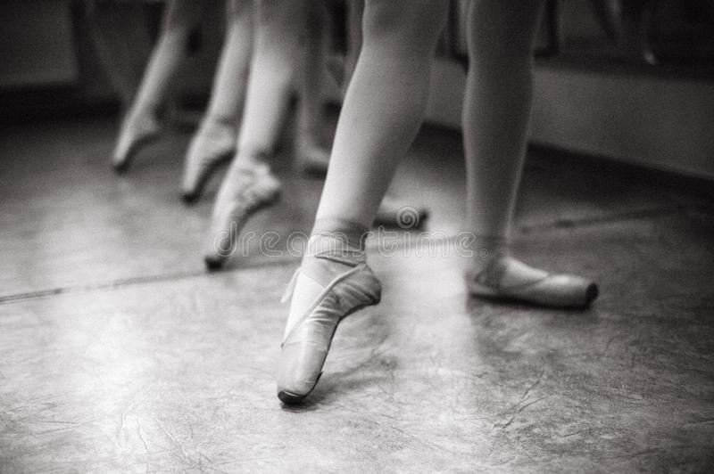 Close-up of ballerina feet on pointe shoes in the dance hall. V. Intage photography stock image