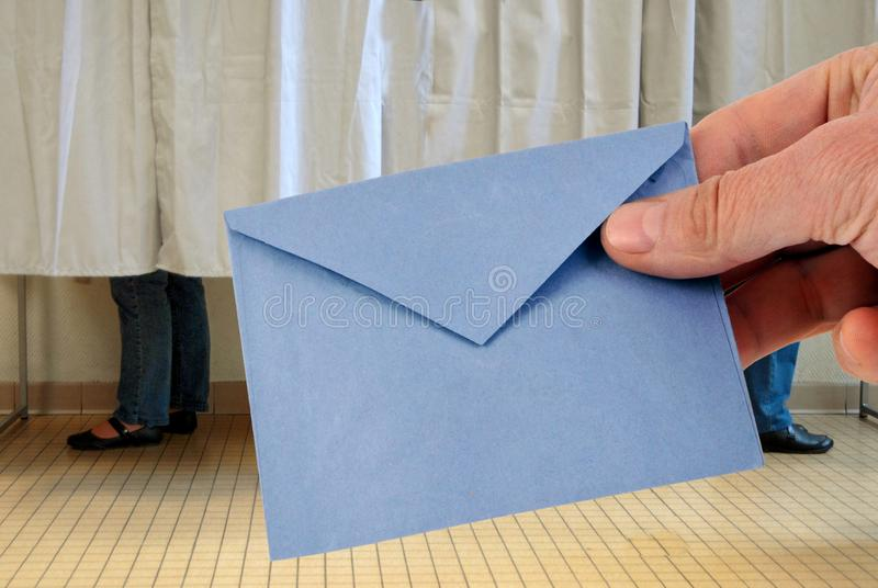 Close-up ballot before the voting booths. Election concept with a ballot close up in front of the booths stock images