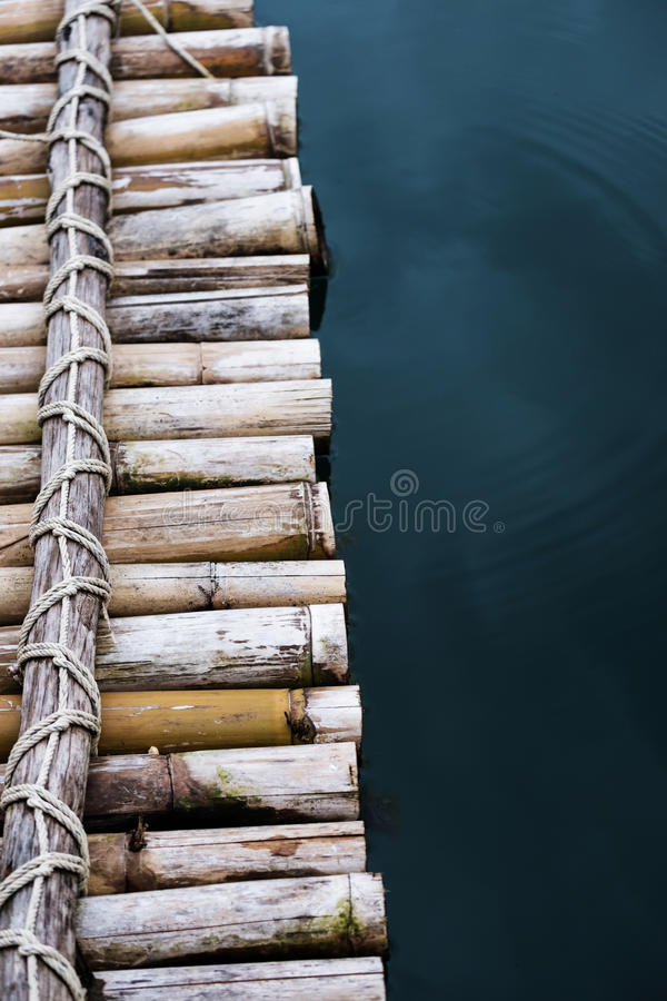 Close-up bamboo raft on the water royalty free stock images