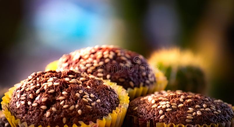 Close up Banana cup cakes with white sesame seeds topping served with fresh coffee, tasty and yummy. Banana cup cake homemade on plate on the table,served with royalty free stock images