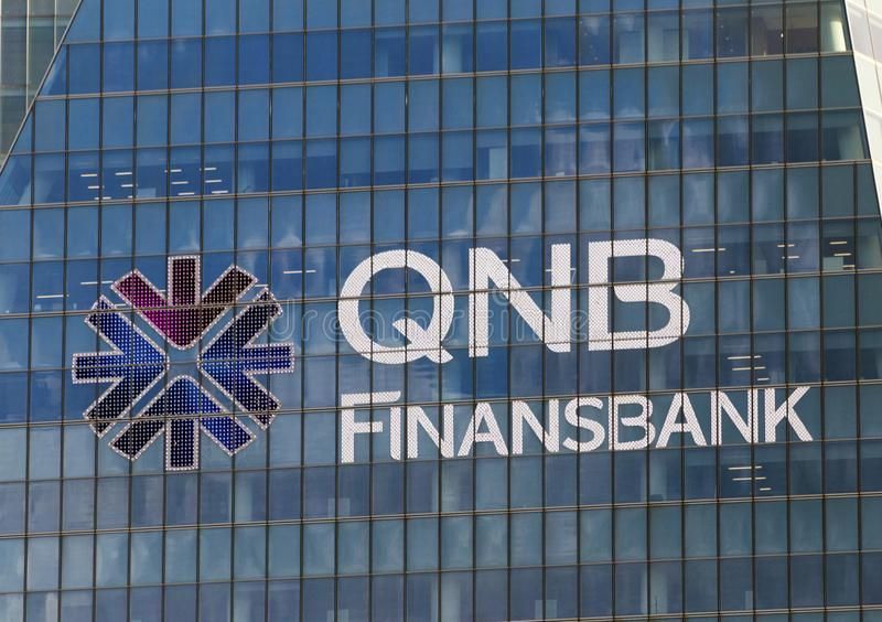 QNB Finansbank Headquarters at Levent, Istanbul, Turkey. Close up of the banner of QNB Finansbank at the exterior of the headquarters` building located at stock image
