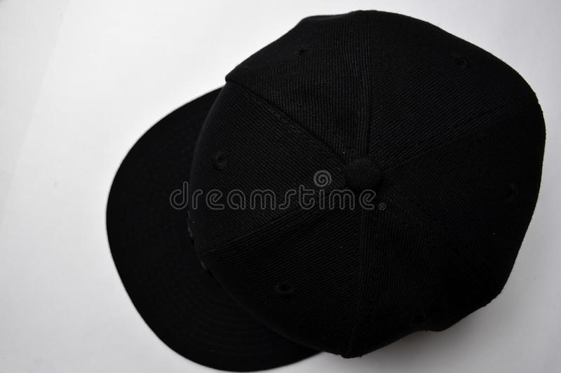 Close up baseball snap back cap color black isolated on a white background stock photography
