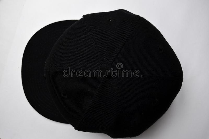Close up baseball snap back cap color black isolated on a white background royalty free stock images