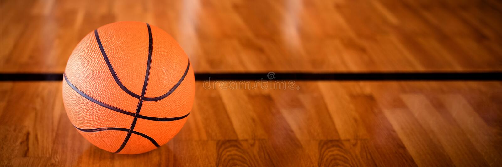 Basketball in the court. Close-up of basketball in the court royalty free stock images