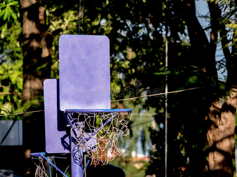 Close up of basketball hoop for little children. In the garden stock photography