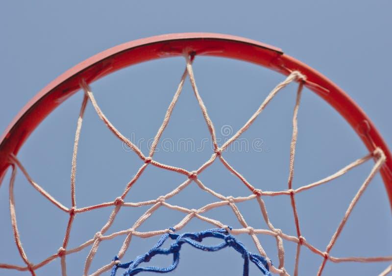 Close-up basketball hoop rim, up ward view a hoop under blue sky royalty free stock photos