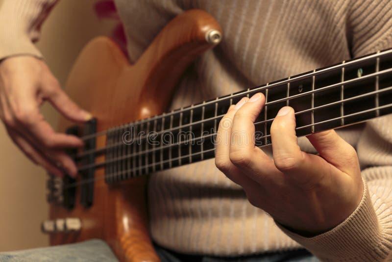 Close-up of a bass guitarist stock photography