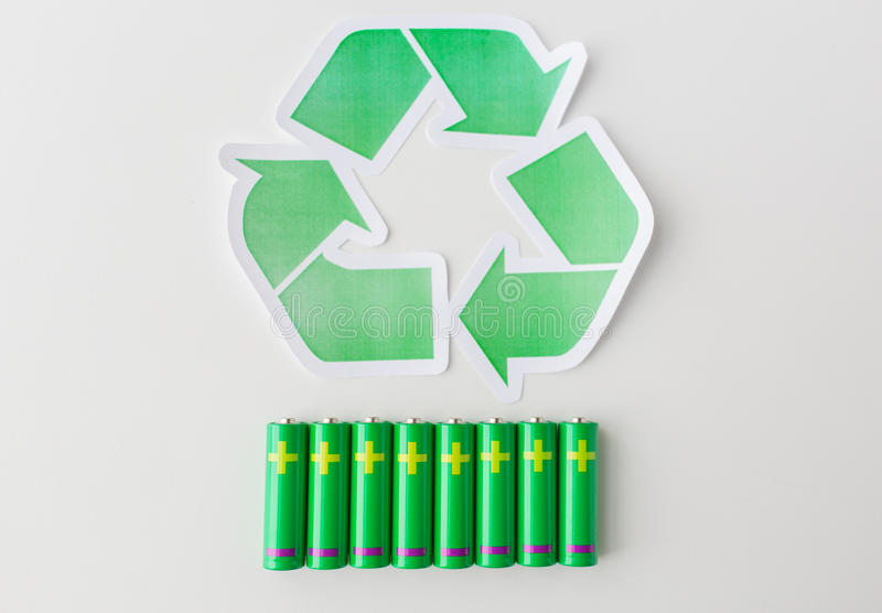Close Up Of Batteries And Green Recycling Symbol Stock Image Image